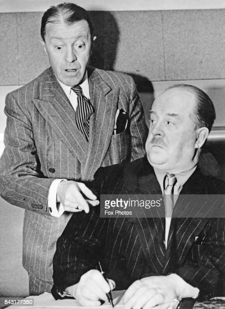 British comedian Tommy Handley star of the BBC radio comedy 'It's That Man Again' or 'ITMA' with the show's writer Ted Kavanagh circa 1940
