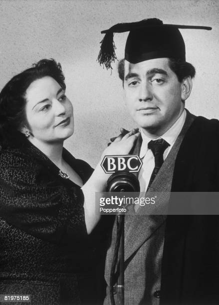 British comedian Tony Hancock and comic actress Hattie Jacques at the microphone for a recording of the BBC radio comedy show 'Educating Archie' 20th...