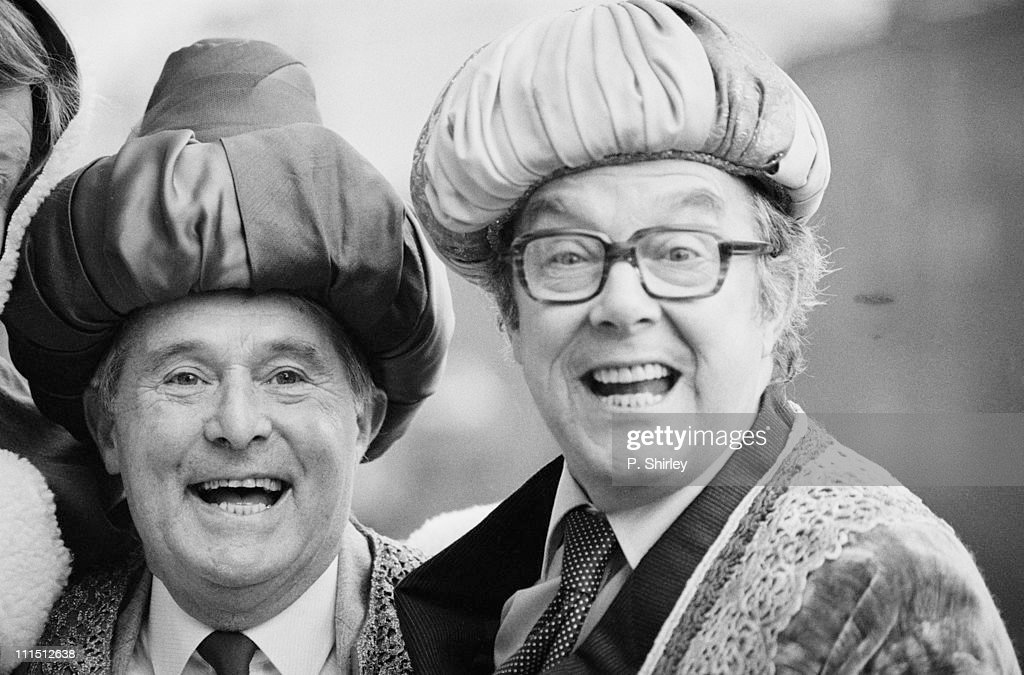 British comedians <a gi-track='captionPersonalityLinkClicked' href=/galleries/search?phrase=Eric+Morecambe&family=editorial&specificpeople=215236 ng-click='$event.stopPropagation()'>Eric Morecambe</a> and <a gi-track='captionPersonalityLinkClicked' href=/galleries/search?phrase=Ernie+Wise&family=editorial&specificpeople=211147 ng-click='$event.stopPropagation()'>Ernie Wise</a> pose in Christmas costumes, 16th December 1983.