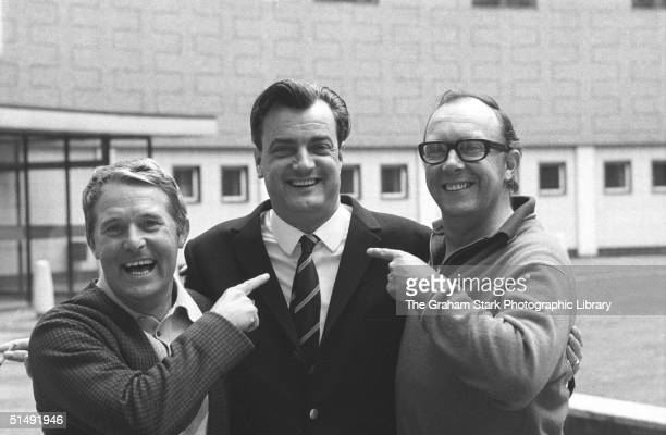 British comedians Ernie Wise left and Eric Morecambe pointing to their writer Eddie Braben who stands between them at the BBC Television Centre in...