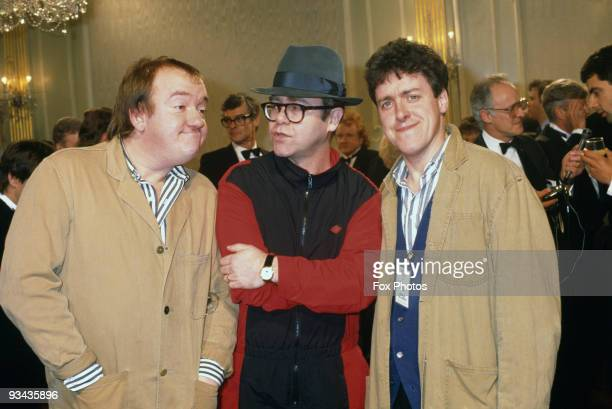 British comedians Mel Smith and Griff Rhys Jones stars of the new TV comedy series 'The World According To Smith and Jones' with singer Elton John at...
