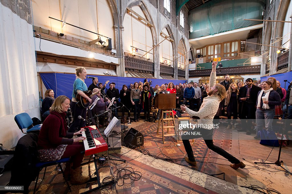 British comedians Sanderson Jones and Pippa Evans cofounders of The Sunday Assembly an atheist service held at a converted church lead the...