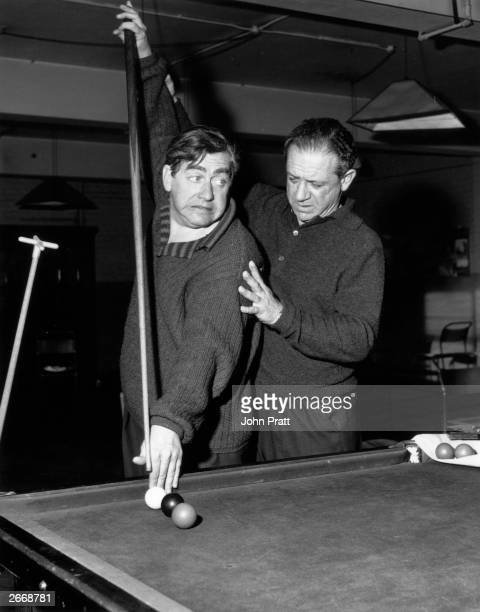 British comedians Tony Hancock and Sid James honing their snooker skills