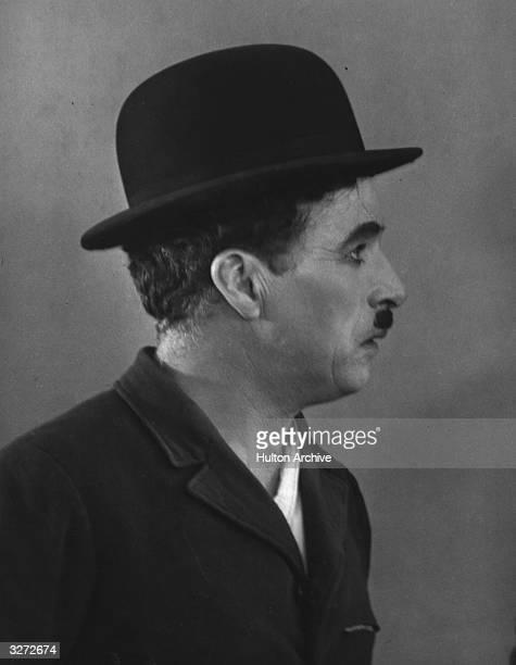 British comic actor and director Charles Chaplin who worked in British pantomime before travelling to Hollywood in 1910 directs and stars in 'Modern...