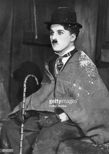British comic actor and director Charlie Chaplin as the Little Tramp wearing a burlap shawl in a still from 'The Gold Rush' directed by Chaplin