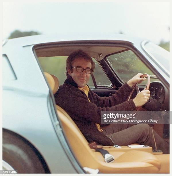 British comic actor Peter Sellers at the wheel of his Ferrari 275 GTB circa 1965