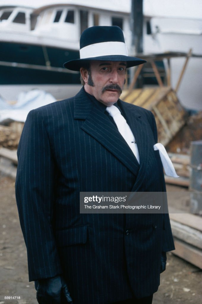 British comic actor Peter Sellers (1925 - 1980) in disguise as a gangster during filming of 'The Revenge of the Pink Panther', directed by Blake Edwards, 1978. The film marked Sellers' last appearance as Inspector Jacques Clouseau.