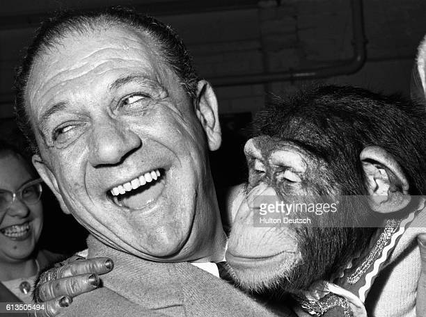 British comic actor Sid James makes friends with a chimpanzee London 1961