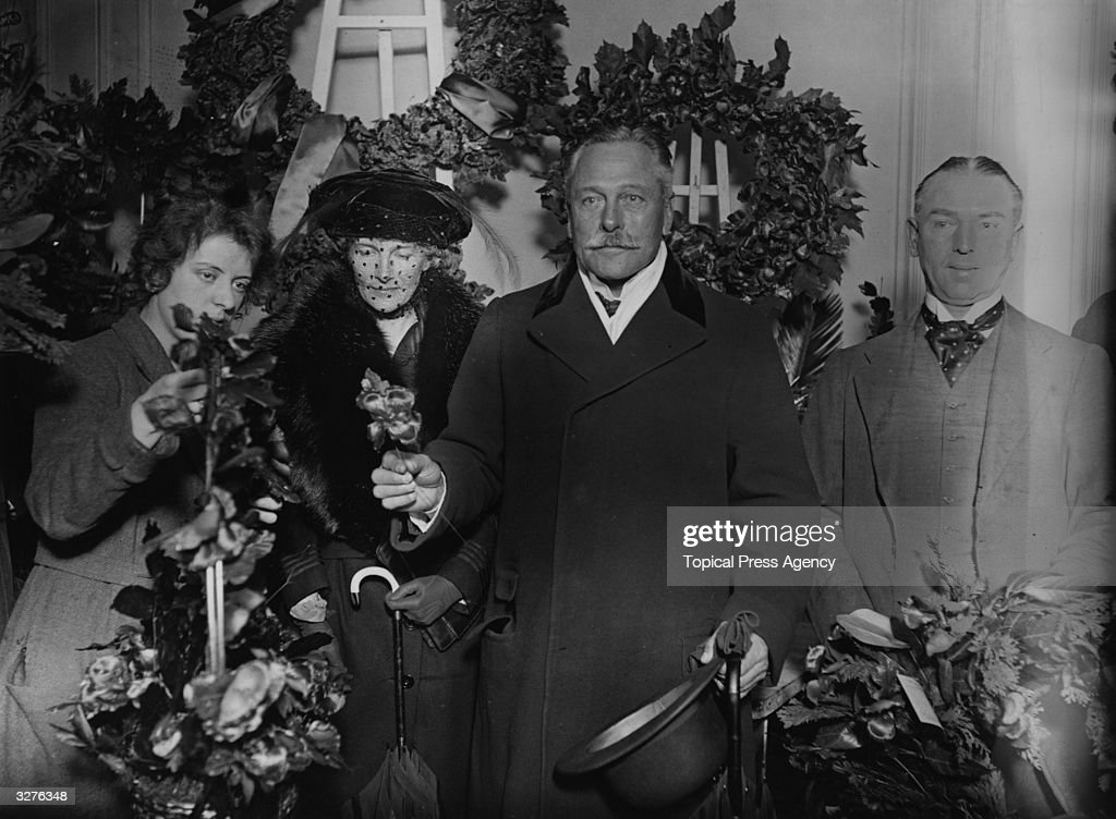 British commander during World War One Field Marshal Sir Douglas Haig (1861 - 1928) and his wife Dorothy (1879 - 1939) inspect poppies, November 1921.