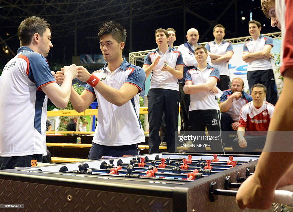 British competitors celebrate after scoring during the ITSF 2013 table soccer (aka babyfoot) World Cup on January 4, 2013 in Nantes, western France.