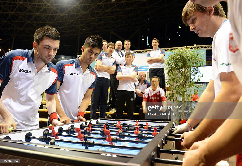 British competitors (L) take part in the ITSF 2013 table soccer (aka babyfoot) World Cup on January 4, 2013 in Nantes, western France.