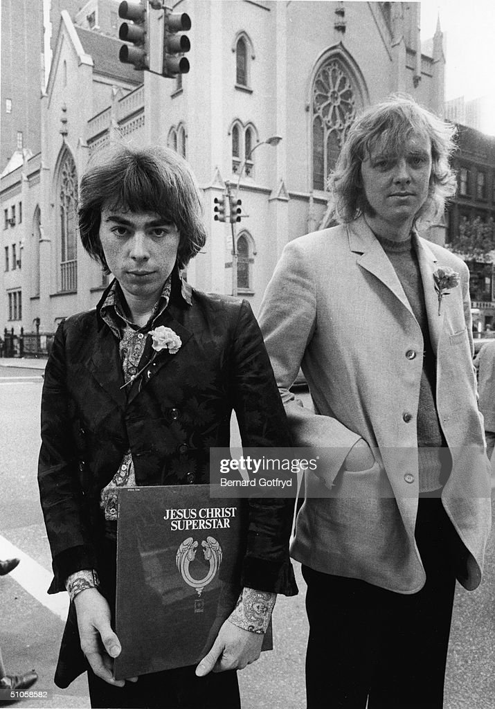 British composer Andrew Lloyd Webber and lyricist Tim Rice pose with a copy of the American pressing of the original cast album of their rock opea...