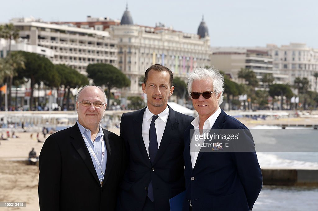 British concert promoter Harvey Goldsmith, Gucci's head of Marketing and Communications Robert Triefus and US producer Kevin Wall pose on April 10, 2013 during the MIPTV in Cannes, southeastern France, to present the 'Chime for Change' concert to be held on June 1st in London. Chime for Change, founded by Gucci, is a new, global campaign focused on girls' and women's empowerment.