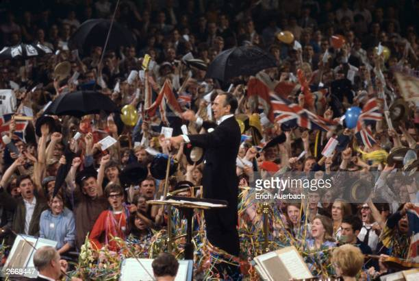 British conductor Sir Malcolm Sargent conducts the Last Night of the 1966 Proms or Promenade Concerts in the Royal Albert Hall London Sargent...
