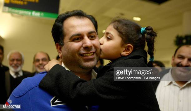 British Conservative MEP Sajjad Karim gets a kiss from his daughter Rabia as he arrives back at Manchester Airport Mr Karim was forced to flee to a...