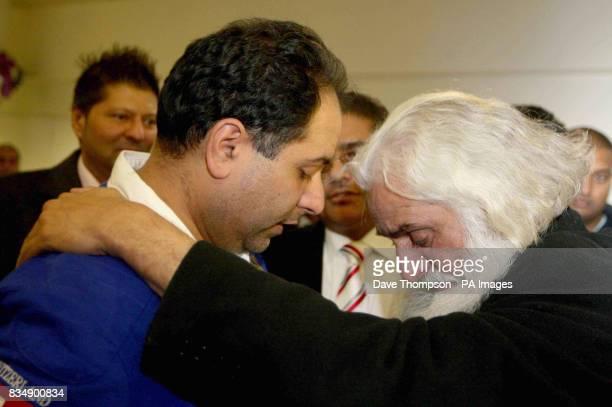 British Conservative MEP Sajjad Karim is greeted by a wellwisher as he arrives back at Manchester Airport Mr Karim was forced to flee to a 'safe'...