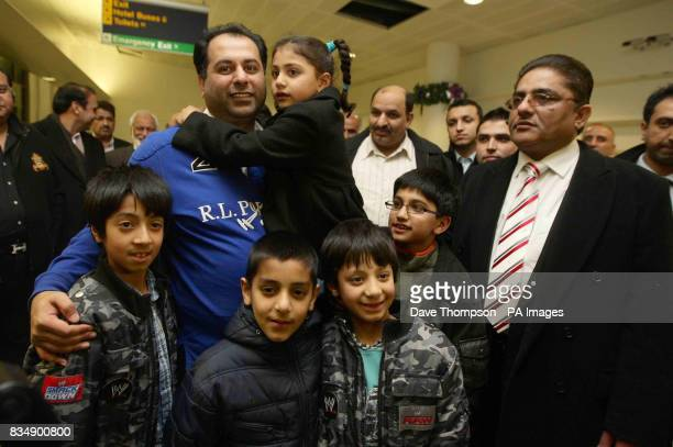 British Conservative MEP Sajjad Karim is met by friends and family as he arrives back at Manchester Airport Mr Karim was forced to flee to a 'safe'...