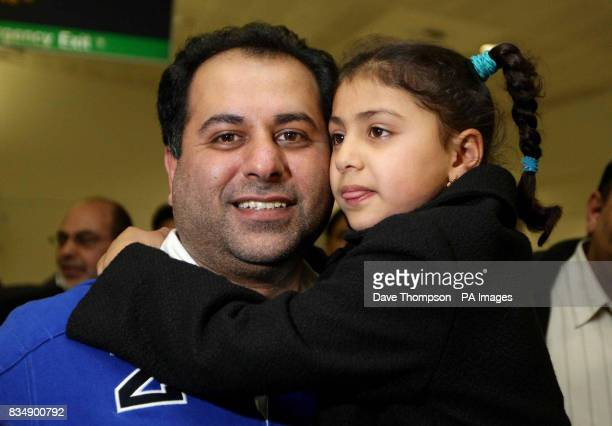 British Conservative MEP Sajjad Karim with his daughter Rabia as he arrives back at Manchester Airport Mr Karim was forced to flee to a 'safe'...