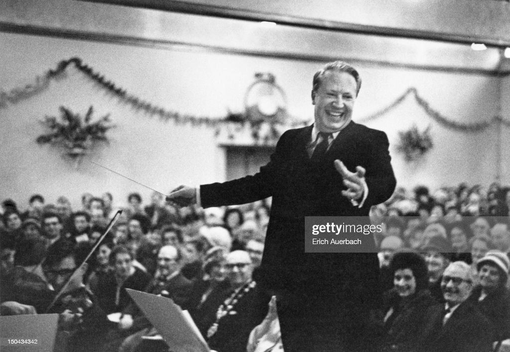 British Conservative Party politician and amateur musician Edward Heath conducting the annual carol concert at the Grand Ballroom Broadstairs Kent...