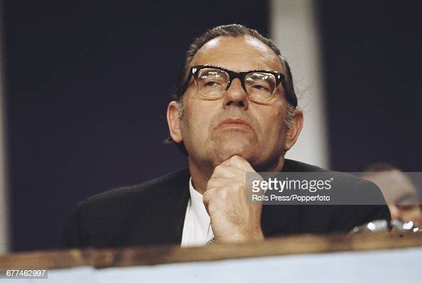 British Conservative Party politician and Home Secretary Reginald Maudling pictured listening to proceedings from the platform at the Conservative...