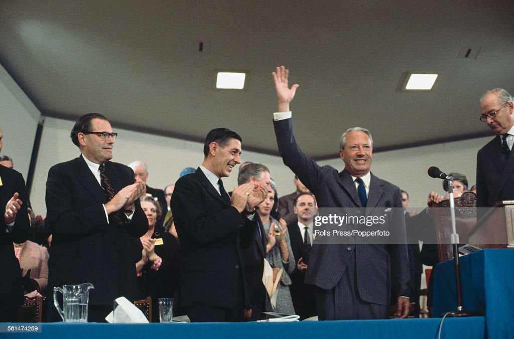 British Conservative Party politician and Leader of the Conservative Party Edward Heath waves to party members in the audience after delivering a...