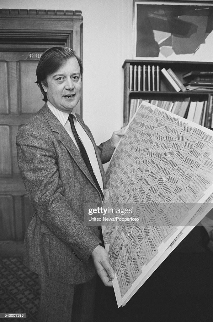 British Conservative Party politician and Member of Parliament for Rushcliffe in Nottinghamshire Kenneth Clarke pictured holding up a board of text...