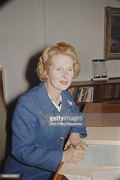 British Conservative Party politician and new Secretary of State for Education and Science Margaret Thatcher pictured sitting at her desk in the...
