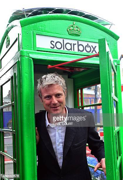 British Conservative Party politician Zac Goldsmith poses for pictures inside the first traditional London telephone box to be transformed into a...