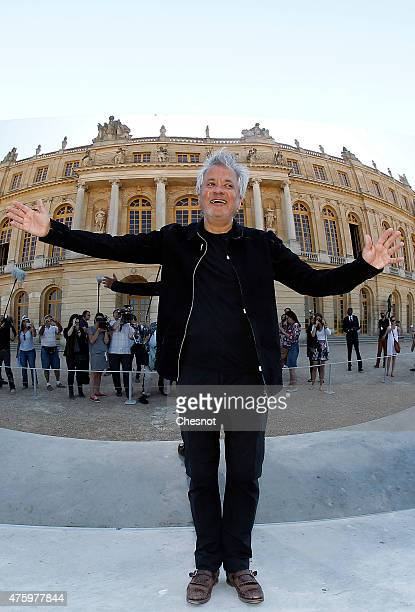 British contemporary artist of Indian origin Anish Kapoor poses in front of his artwork named 'CCurve' at the opening of his exhibition of his works...