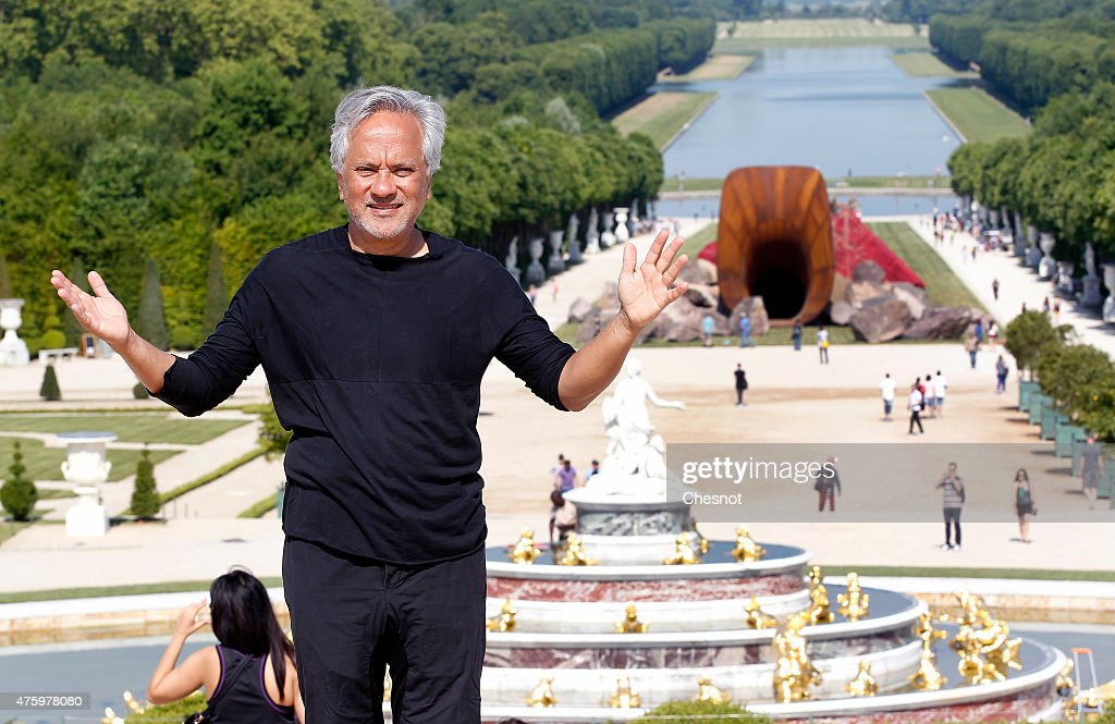British contemporary artist of Indian origin <a gi-track='captionPersonalityLinkClicked' href=/galleries/search?phrase=Anish+Kapoor&family=editorial&specificpeople=3965986 ng-click='$event.stopPropagation()'>Anish Kapoor</a> poses in front of his artwork named 'Dirty Corner' at the opening of his exhibition of his works in the gardens of the Chateau de Versailles on June 5, 2015, in Versailles, France. This exhibition takes place from June 9 until November 01, 2015 in the gardens of the 'Chateau de Versailles'.