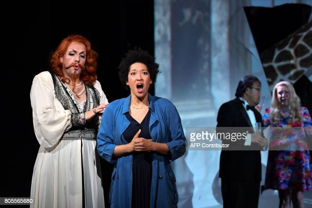 British countertenor Andrew Watts as Baba The Turk and US soprano Julia Bullock as Ann Trulove perform Igor Stravinski's opera 'The Rake's Progress'...