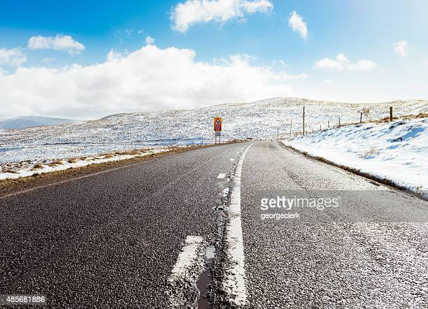 British country road in winter snow
