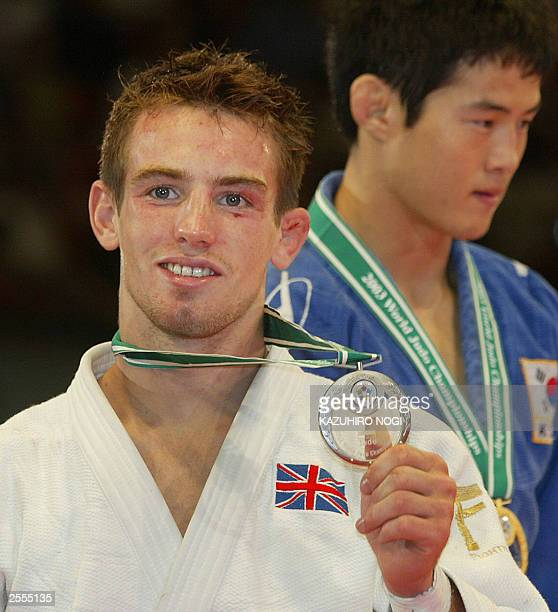 British Craig Fallon silver medalist of the men's under 60kg final shows his medal during the award ceremony of the World Judo Championships in Osaka...