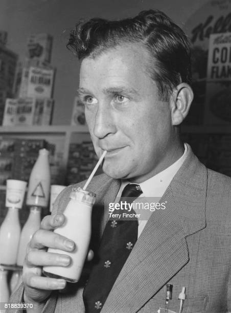 British cricketer Jim Laker inaugurates National Milk Week at a Vauxhall dairy London 20th June 1956