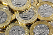 Scattered one pound coins