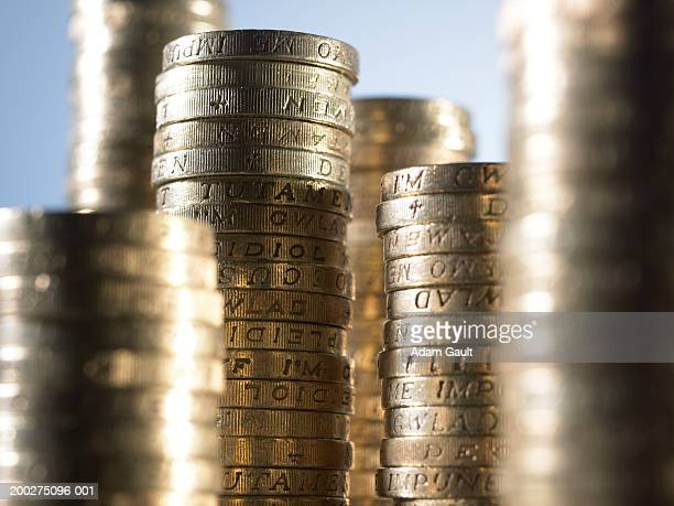 British Currency: Stacked pound coins at varying heights, side view