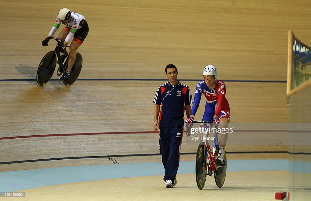 British Cycling Coach <a gi-track='captionPersonalityLinkClicked' href=/galleries/search?phrase=Chris+Newton&family=editorial&specificpeople=802639 ng-click='$event.stopPropagation()'>Chris Newton</a> (c) chats to John Dibbon as they walk around the track during training for the UCI Track Cycling World Cup at the Sir Chris Hoy Velodrome on November 15, 2012 in Glasgow, Scotland.