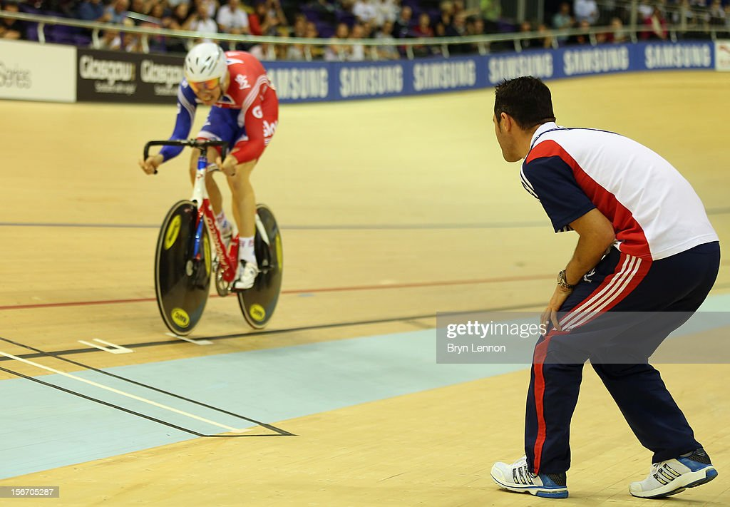 British Cycling Coach <a gi-track='captionPersonalityLinkClicked' href=/galleries/search?phrase=Chris+Newton&family=editorial&specificpeople=802639 ng-click='$event.stopPropagation()'>Chris Newton</a> encourages John Dibbon on day one of the UCI Track Cycling World Cup at the Sir Chris Hoy Velodrome on November 16, 2012 in Glasgow, Scotland.