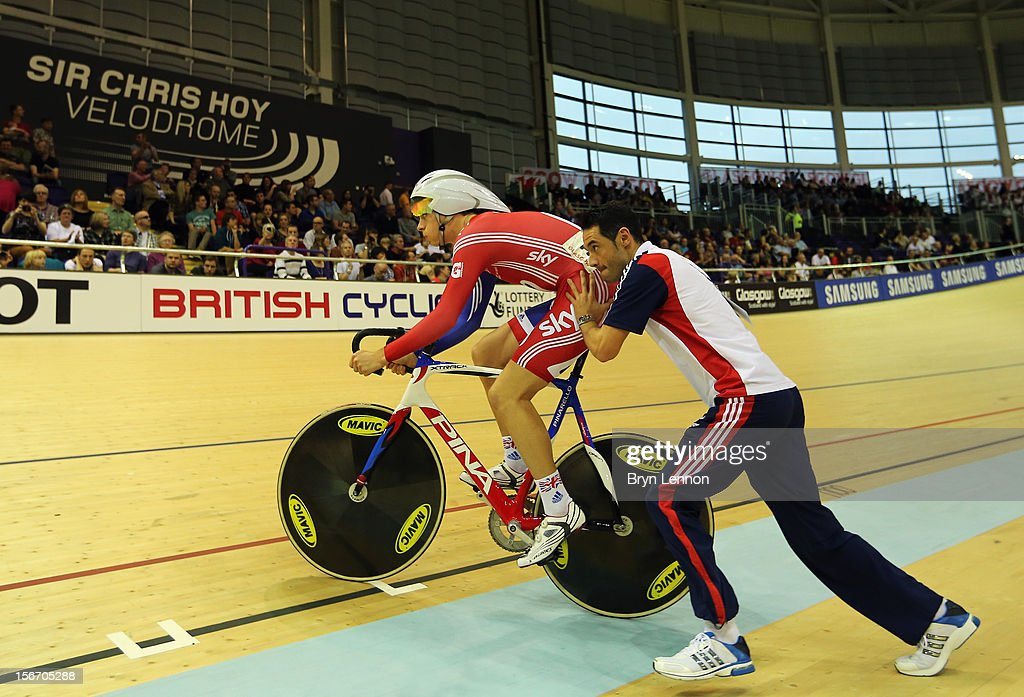 British Cycling Coach <a gi-track='captionPersonalityLinkClicked' href=/galleries/search?phrase=Chris+Newton&family=editorial&specificpeople=802639 ng-click='$event.stopPropagation()'>Chris Newton</a> pushes John Dibbon up onto the track on day one of the UCI Track Cycling World Cup at the Sir Chris Hoy Velodrome on November 16, 2012 in Glasgow, Scotland.