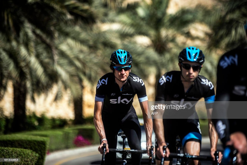 British cyclist Bradley Wiggins (L) of the Sky Procycling team rides his bike with his team during a training session the day before the first stage of the Tour of Oman, on February 10, 2013, in Muscat.