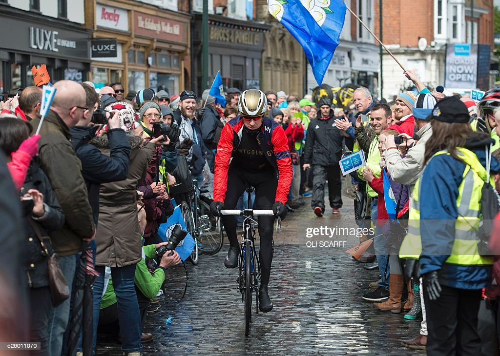 British cyclist Bradley Wiggins, riding for Team Wiggins, makes his way to the start line to compete in the first stage of the Tour de Yorkshire, in Beverley, north east England, on April 29, 2016. / AFP / OLI