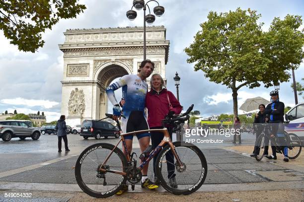 British cyclist Mark Beaumont poses for pictures with his mother after arriving at the Arc de Triomphe in Paris on September 18 2017 to complete his...
