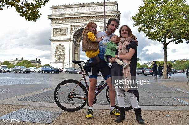 British cyclist Mark Beaumont poses with his family after arriving at the Arc de Triomphe in Paris on September 18 2017 to complete his tour around...