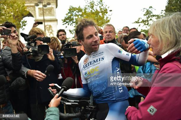 British cyclist Mark Beaumont speaks to the press after arriving at the Arc de Triomphe in Paris on September 18 2017 to complete his tour around the...
