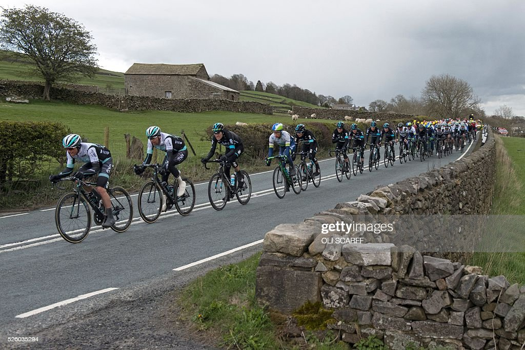 British cyclist Peter Williams (L) of the ONE Pro Cycling team, leads teammates as they comptete in the first stage of the Tour de Yorkshire, in Long Preston, northern England, on April 29, 2016. / AFP / OLI