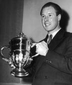 British cyclist Reg Harris receives the 'Sportsman of the Year' trophy at the Savoy Hotel London 29th March 1950 Harris won silver medals in the...