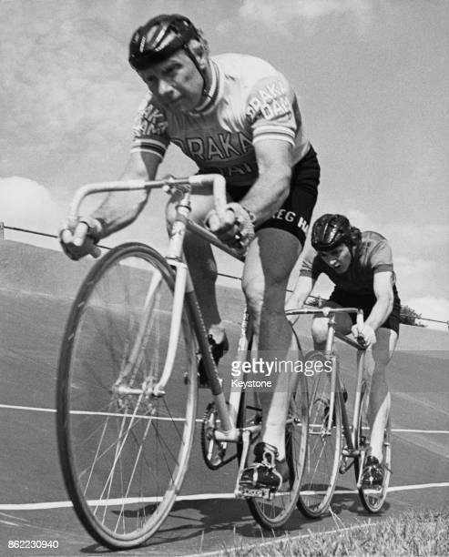 British cyclist Reg Harris trains for the British professional sprint cycle championships at Fallowfield Stadium in Manchester with Manchester sprint...
