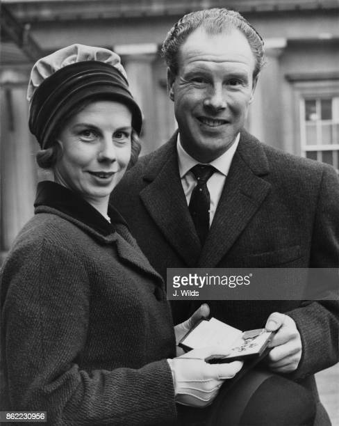 British cyclist Reg Harris with his wife after receiving his OBE at Buckingham Palace in London 11th November 1958