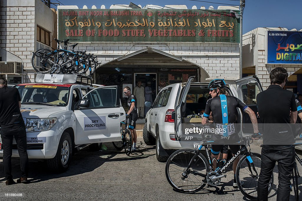 British cyclists Bradley Wiggins (R ) and Chistopher Froome (L) of Sky Pro Cycling team prepare before the start of the second stage of the Tour of Oman, from Fanja in Bidbid to Al Bustan, on February 12, 2013, in Oman. The six-stage race, which follows the Tour of Qatar, won by Britain's Mark Cavendish last week, culminates on Saturday at Matra Corniche.