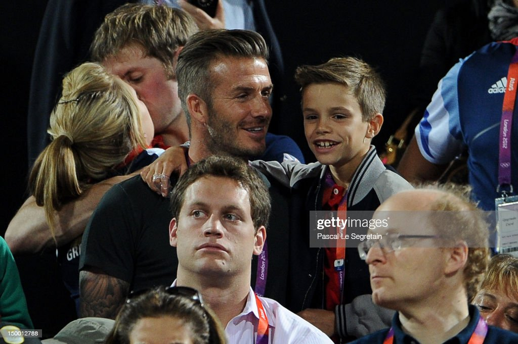 British cyclists Laura Trott and Jason Kenny, David Beckham and Romeo Beckham during the Beach Volleyball on Day 12 of the London 2012 Olympic Games at Horse Guards Parade on August 8, 2012 in London, England.